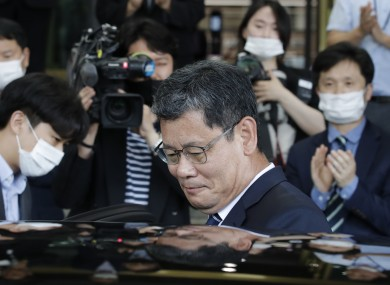 South Korea's unification minister Kim Yeon-chul gets into a car as he leaves the government complex in Seoul today.