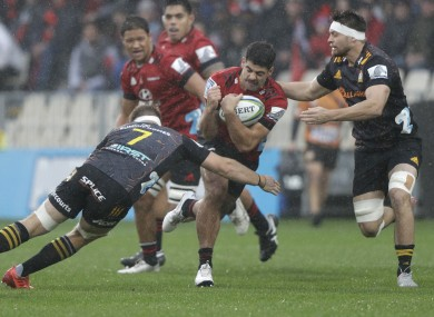 Crusaders' Billy Harmon is tackled by Sam Cane of the Chiefs during the Super Rugby Aotearoa clash in Christchurch.