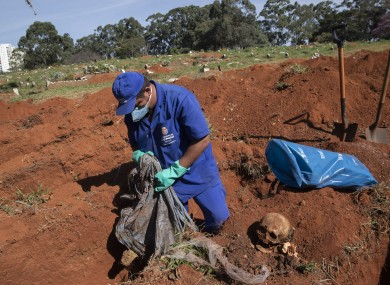 Cemetery workers exhume remains buried three years ago at the Vila Formosa cemetery, which does not charge families for the gravesites, in Sao Paulo, Brazil, yesterday.