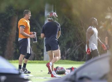 Tom Brady, left, looks on while working out with Buccaneers team-mates last month.