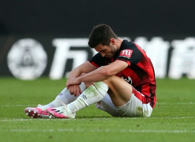 AFC Bournemouth's Lewis Cook is dejected at the final whistle.