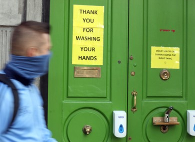 A man walks by a closed pub in Dublin (file photo)