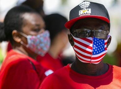 Thomas Azard (65) participates in a Strike for Black Lives protest outside Miami Beach City Hall yesterday.