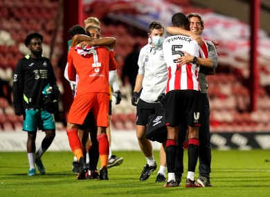 Brentford manager Thomas Frank (right) celebrates victory with Ethan Pinnock.