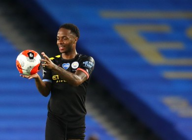 Raheem Sterling collects the match ball.