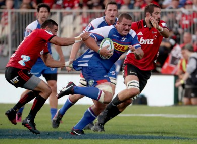 Bryn Hall of South Africa's Stormers under pressure during a game against New Zealand's Crusaders.