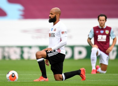 Sheffield United and Ireland's David McGoldrick takes a knee in a protest against racism during a Premier League match with Burnley.