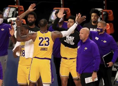 LeBron James celebrates with his team-mates