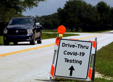 A sign directs people to a drive through COVID-19 testing site operated by the Florida Department of Health.