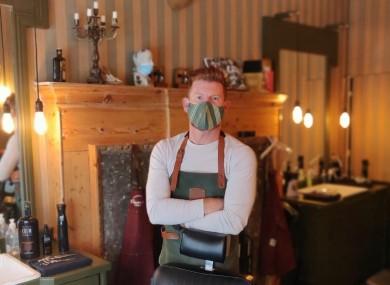 Luke Delaney in his barbershop in Dublin city centre