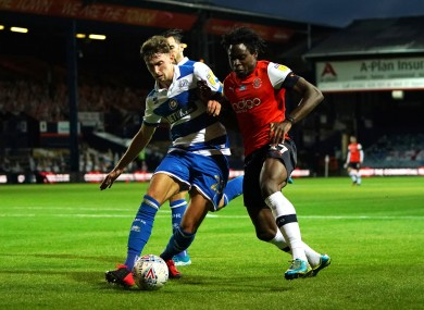 Conor Masterson (left) tackles Pelly Ruddock Mpanzu during the recent Championship game between QPR and Luton Town.