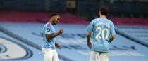 Raheem Sterling and Bernardo celebrate the former's late goal.
