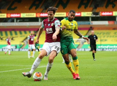 Burnley's Republic of Ireland international Kevin Long tangling with Onel Hernandez of Norwich City.