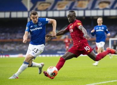 Seamus Coleman putting pressure on Sadio Mane during Everton's recent game against Liverpool.