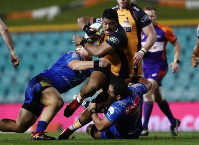 Great Scott: Sio goes on the charge for the Brumbies.