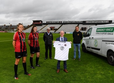 Chloe and Jessica Darby, Chris Brien (president, Bohemian FC), Gerry Carney (Inner City Helping Homeless) and Daniel Lambert (Director, Bohemian FC) at Dalymount Park.