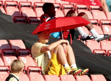 Mesut Ozil, shading from the sun during a June clash with Southampton.