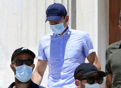 Harry Maguire, center, leaves a court building on the Aegean island of Syros, Greece.