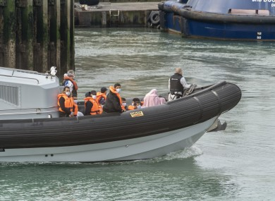 Migrants brought on shore by the border force at Dover port