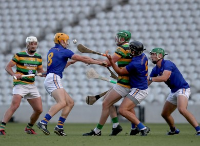 Luke Horgan in action for Glen Rovers against Billy Hennessy and Glen O'Connor for St Finbarr's.