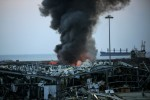 Thick smoke billows from the site where a massive explosion rocked Beirut's port