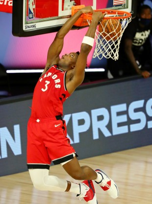 Toronto Raptors forward OG Anunoby makes a reverse dunk against the Brooklyn Nets.