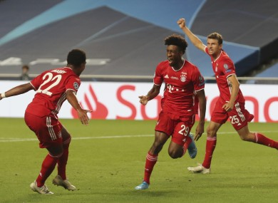 Bayern's Kingsley Coman, centre, celebrates with teammate Thomas Mueller, right, and Serge Gnabry