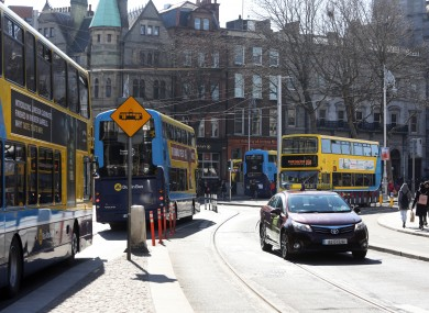 File photo. Buses passing though College Green in Dublin city.