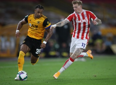 Stoke City's James McClean tangling with Adama Traore of Wolves during last week's Carabao Cup fixture.