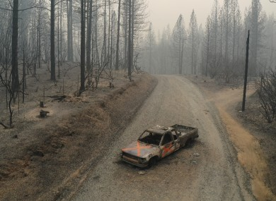 A burned out truck sits on Graystone Lane after the Bear Fire near Lake Oroville in Northern California