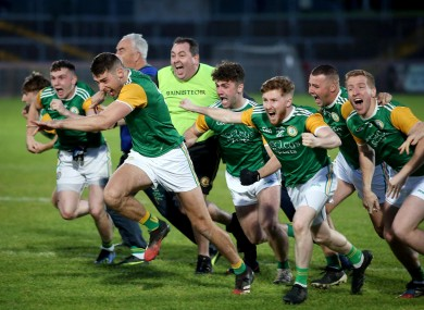 Dungannon's players celebrate after their penalty shootout win in the Tyrone final.