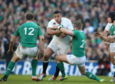 Luther Burrell in possession for England during a 2015 Six Nations game against Ireland.