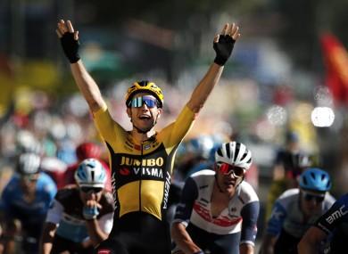 Wout van Aert celebrates as he crosses the finish line.