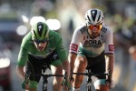 Sam Bennett (left) duels with Peter Sagan during today's 19th stage at the Tour de France.
