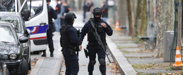 Riot police officers arrive after four people were wounded in a knife attack near the former offices of Charlie Hebdo magazine