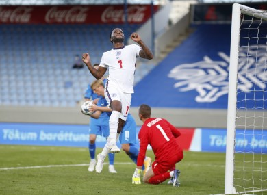 England's Raheem Sterling celebrates after scoring the opening goal from the penalty spot.