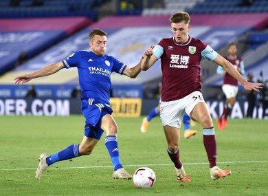 Leicester City's Jamie Vardy and Burnley's Jimmy Dunne do battle.