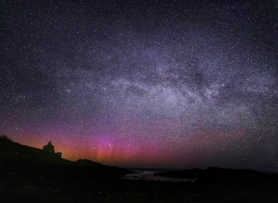 The Northern Lights, the Milky Way and Lyrid meteors falling through the sky at the Bathing House near Howick, Northumberland, in April.