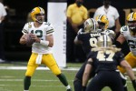 Green Bay Packers quarterback Aaron Rodgers looks to pass against the New Orleans Saints.