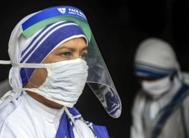 Nuns wear masks and face shields in Kolkata, India.