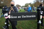 Protesters placing baby shoes on a sign for the Áras today.