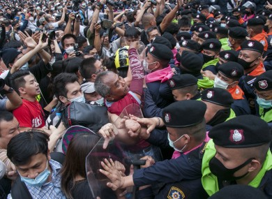 Protesters clash with riot policemen during a demonstration in Bangkok
