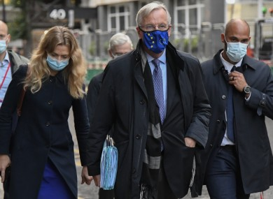 EU Chief negotiator Michel Barnier wears a face mask as he walks to The Westminster Conference Centre
