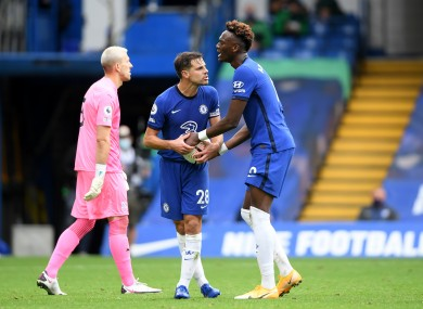 Chelsea's Cesar Azpilicueta (centre) argues with Tammy Abraham over who should take the second penalty.