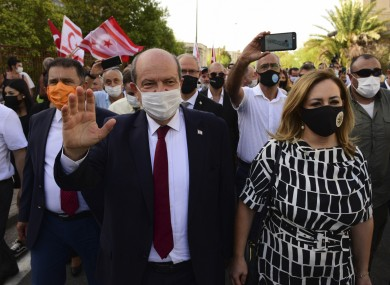 Ersin Tatar, prime minister of a self-declared Turkish Cypriot state recognized only by Turkey, waves as he walks in Varosha yesterday.