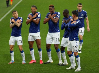 The Everton players celebrate a goal against Brighton.
