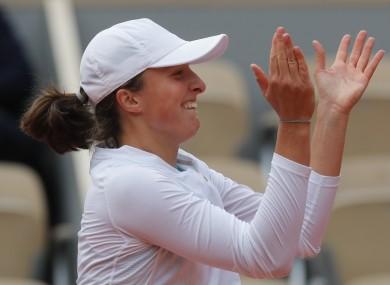 Iga Swiatek celebrates her victory today.