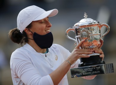 Poland's Iga Swiatek holds the French Open trophy.