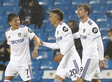 Leeds United's Rodrigo (centre) celebrates with team-mates Ian Poveda (left) and Patrick Bamford.