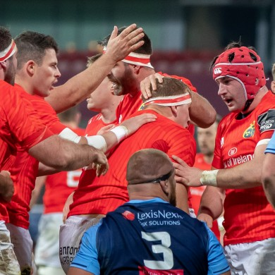 Munster players congratulate try scorer Gavin Coombes.